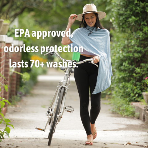 """Pang Wangle insect shield clothing brand with model walking a bike wearing optimist pants bug repellent leggings and a faded denim essential wrap with Insect Shield, and text quote overlaid says """"EPA approved odorless protection lasts 70+ washes."""""""