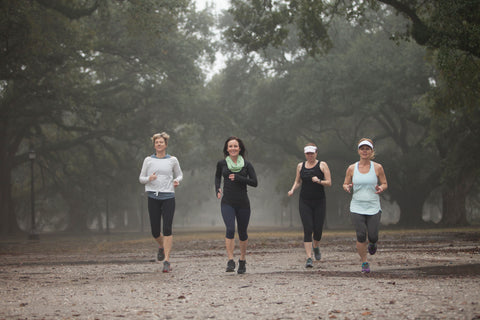 Caroline Brady and her Fit Camp class run under the oak trees in Audubon Park on a foggy morning.