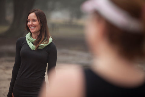 outdoor fitness trainer Caroline Brady smiles while wearing the bug repellent Pang Wangle Journey Scarf and working out on a misty morning in New Orleans.