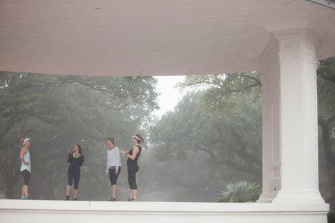 Women laughing during a work out on a foggy morning in Audubon Park, New Orleans