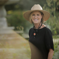 Jennifer John Pang Wangle Founder and CEO New Orleans filmmaker in Audubon Park wearing Nautica Palm Straw Hat