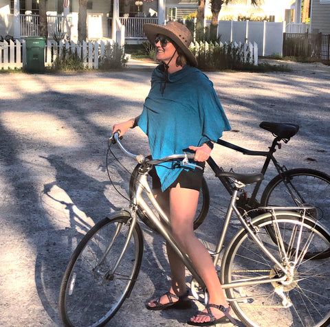 PANG WANGLE founder Jennifer John in the Teal Essential Wrap with Insect Shield in Grayton Beach Florida