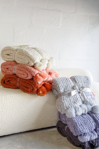 Plush Cable Knit Throw with Pom-Poms