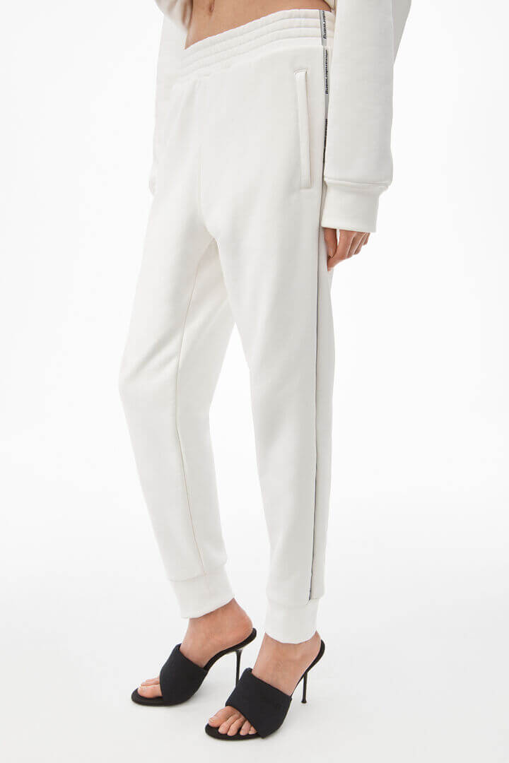 Alexander Wang Slim Track Sweatpant with Logo Tape in White from The New Trend