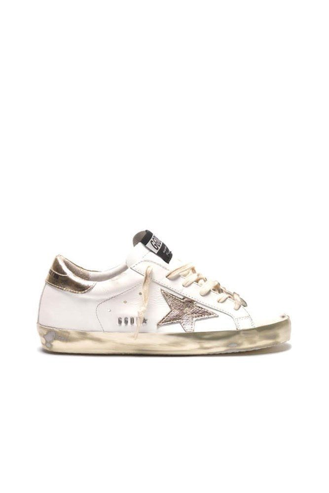 Golden Goose Superstar Sneakers in White and Gold from The New Trend