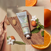 Mademoiselle Provence Almond and Orange Blossom hand cream made for sensitive skin. Natural nourishing and soothing hand lotion made in France by Miss France 2009. 95.8% Natural. Helps soothe, restore, and heal dry or sensitive skin. Photo collage of lotion, woman, and oranges.