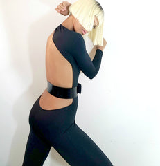 Nik Spruill brand, siide view, model Nicole Spruill blonde platinum hairstyle, bob hairstyle, One Strut Models one shoulder jumpsuit don't do it video