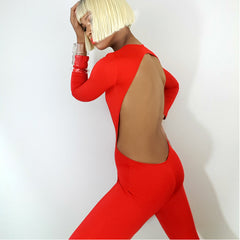 back view backless jumpsuit, one strut models jumpsuit video, nicole spruill, nik spruill brand, bold color jumpsuit red low cut