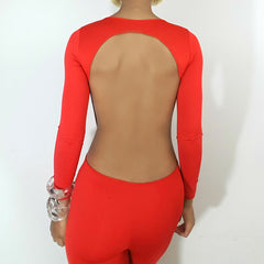 back view, red jumpsuit model Nicole Spruill Nik Spruill brand One Strut Models ready-to-wear collection