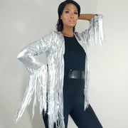 Nicole Spruill model, Front view, Silver steel heavy sequined fringe jacket, patent leather belt, one strut models don't do it vide black one shoulder jumpsuit, celebrity stylist high fashion haute couture