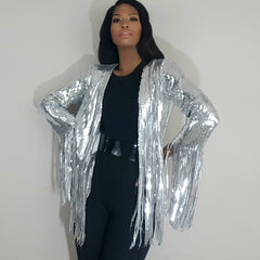 Nicole spruill, front view hands on hips, Nik Spruill brand, heavy sequined silver steel fringe jacket, one strut models don't do it video black one shoulder jumpsuit, celebrity stylist high fashion haute couture