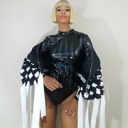 Nicole spruill, high fashion haute couture jacket celebrity stylist, 3d laser cut material ribbon fringe jacket, color block black and white, platinum blonde bob hairstyle, black stretch patent bodysuit