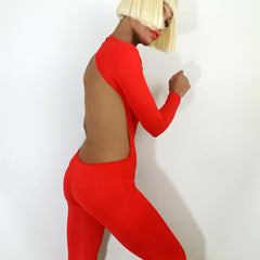 Side view model Nicole Spruill, Nik spruill brand, One Strut Models one shoulder jumpsuit red backless, Fashion designer