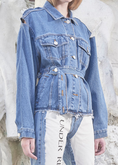 model wearing reconstructed denim jacket with denim pants
