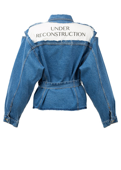 reconstructed denim jacket with text on back