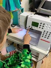 Teaching children to use a sewing machine & making face masks