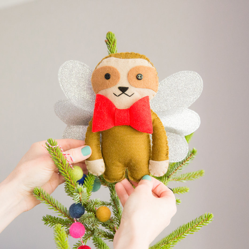 Sloth Christmas Tree Topper on top of tree