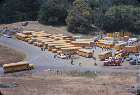 School buses transported everyone to the gig.