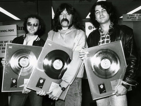 Deep Purple at Heathrow with Perfect Strangers gold discs.