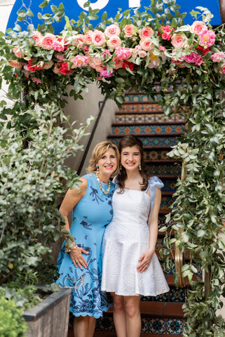 Taylor Turner and Dana Miller under Park Cities Petals Floral Arch Bistro 31