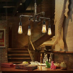 INDUSTRIAL CEILING LAMP, FOUR METAL WATER PIPES. BRUSH GOLD
