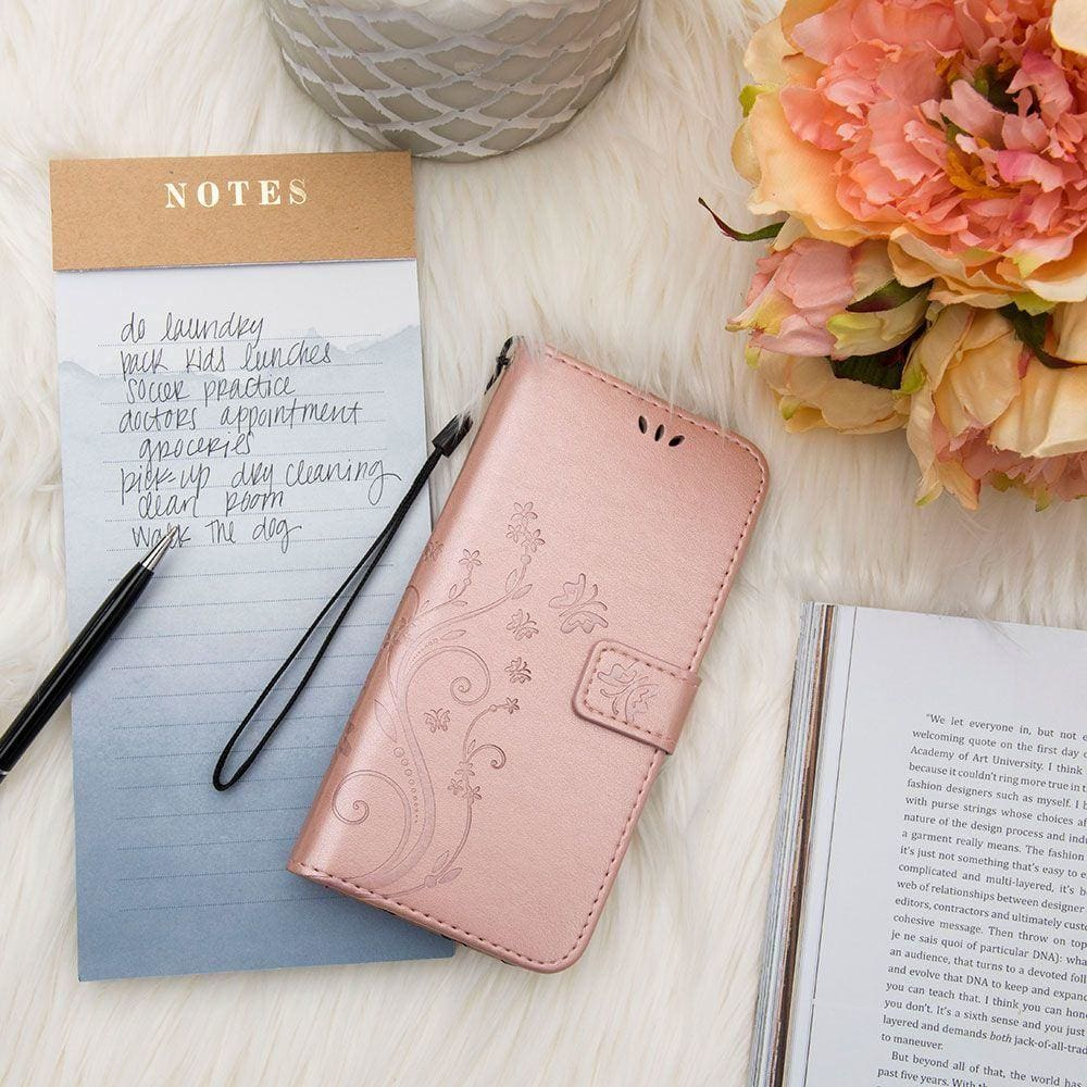 This rose gold butterfly wallet case is not only beautiful, but it is also highly dependable for your travels | CellularOutfitter