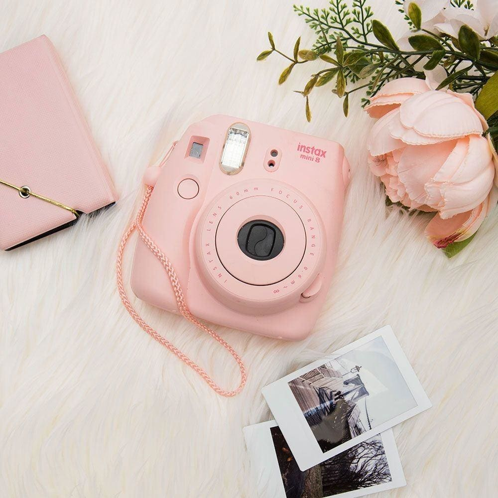 Fujifilm's Instax Mini 8 polaroid camera is great to take on trips because you can have instant copies of your photos! | CellularOutfitter