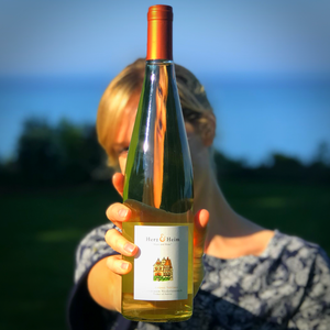 Jessica Bell standing behind a bottle of Gruner Veltliner, perfect for a HaloVino wine tumbler.