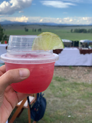 A Huckleberry margarita in a HaloVino wine tumbler with a lime wedge.