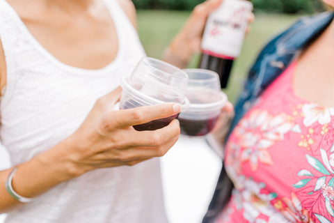 Women toasting with their HaloVino wine tumblers.
