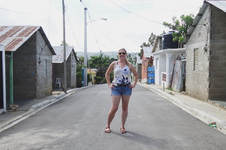 Brave Soles founder Christal Earle stands in the middle of the street in the Dominican Republic.