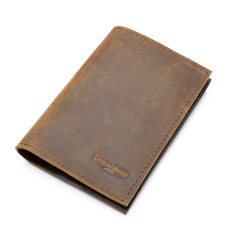 The Viajero Passport Holder is made from a crafty combination of leather and recycled tire inner tubes.