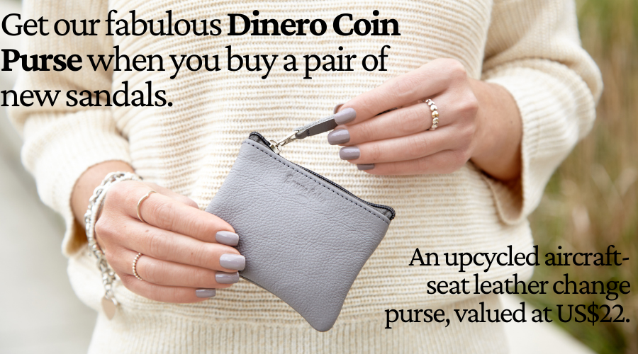 Woman holding the Dinero Coin purse in grey