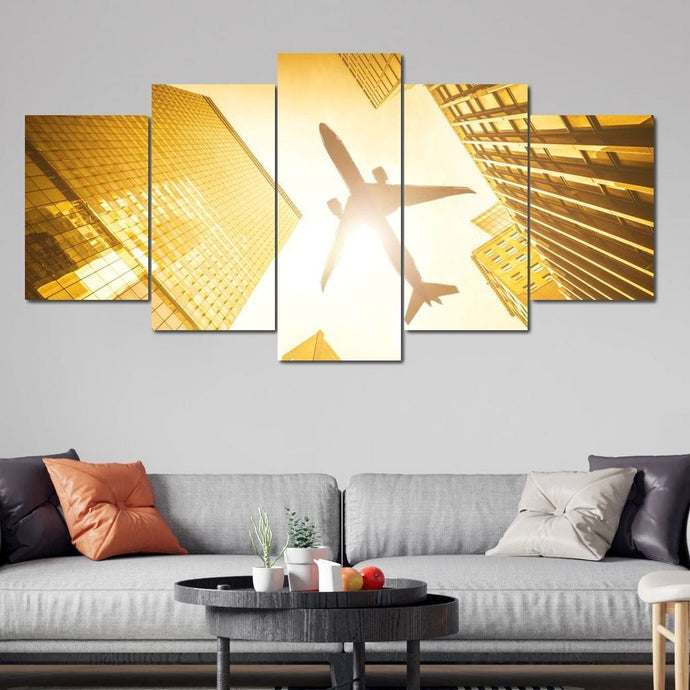 Airplane Over the City Multi Panel Canvas Wall Art - NicheCanvas
