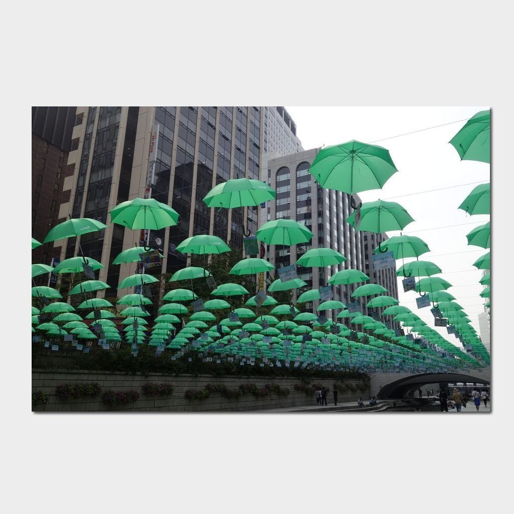 Green Umbrellas of Seoul - Corinne Gravel Multi Panel Canvas Wall Art - NicheCanvas