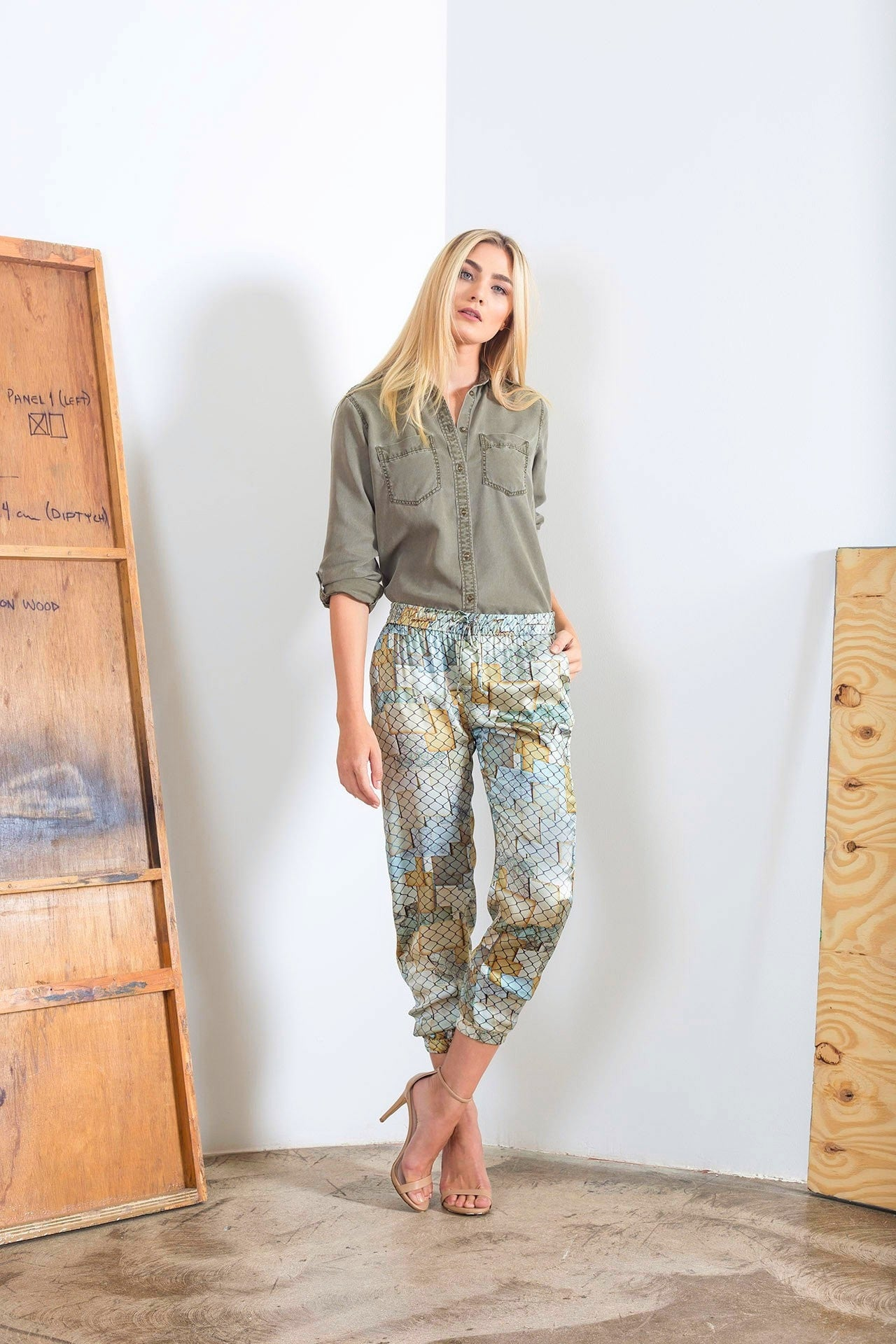 Styled view of silk jogger pants with golden and silver hues designed by artist Mauro Giaconi