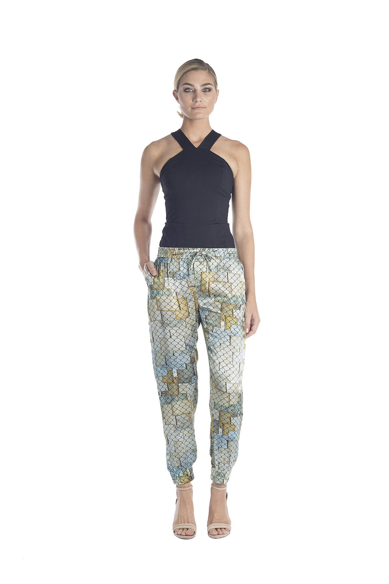 Front view of silk jogger pants with golden and silver hues designed by artist Mauro Giaconi