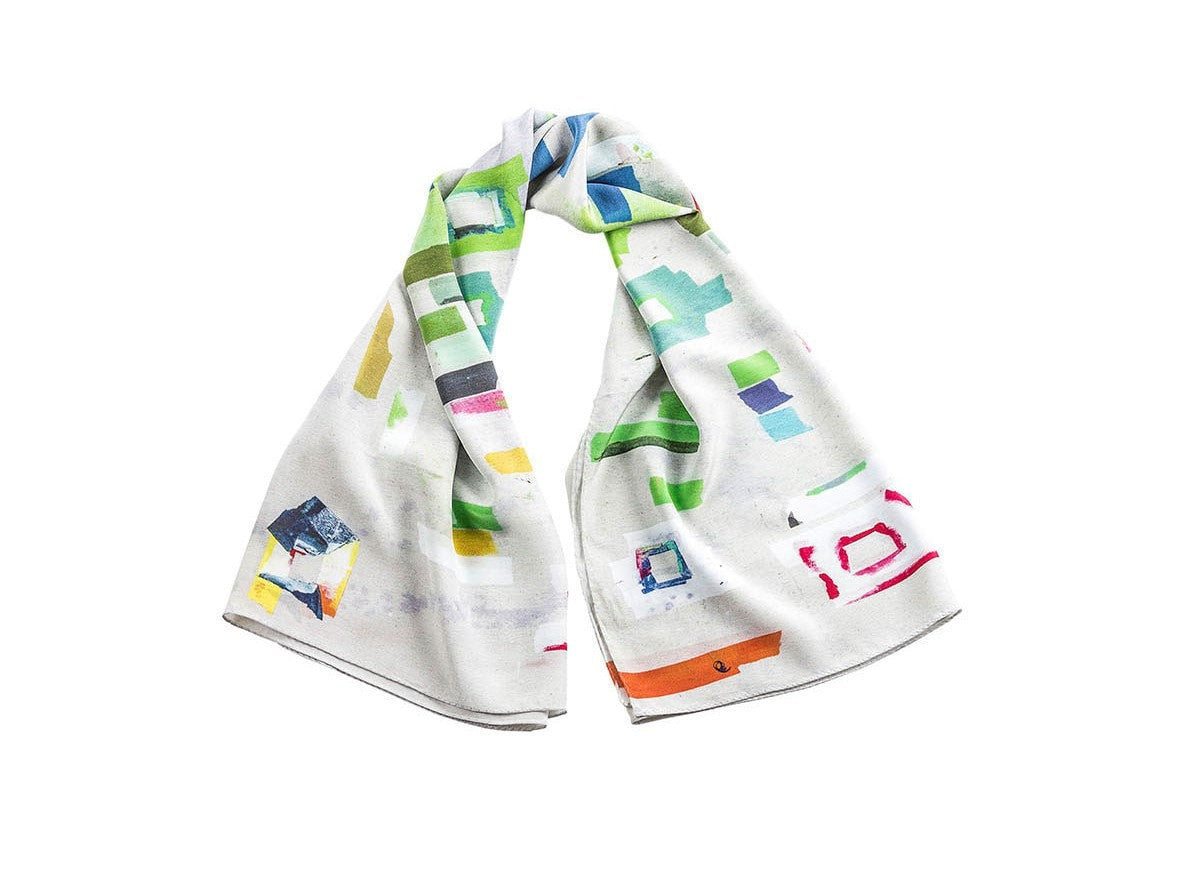 Folded view of luxury silk scarves with print designed by NY artist Franklin Evans