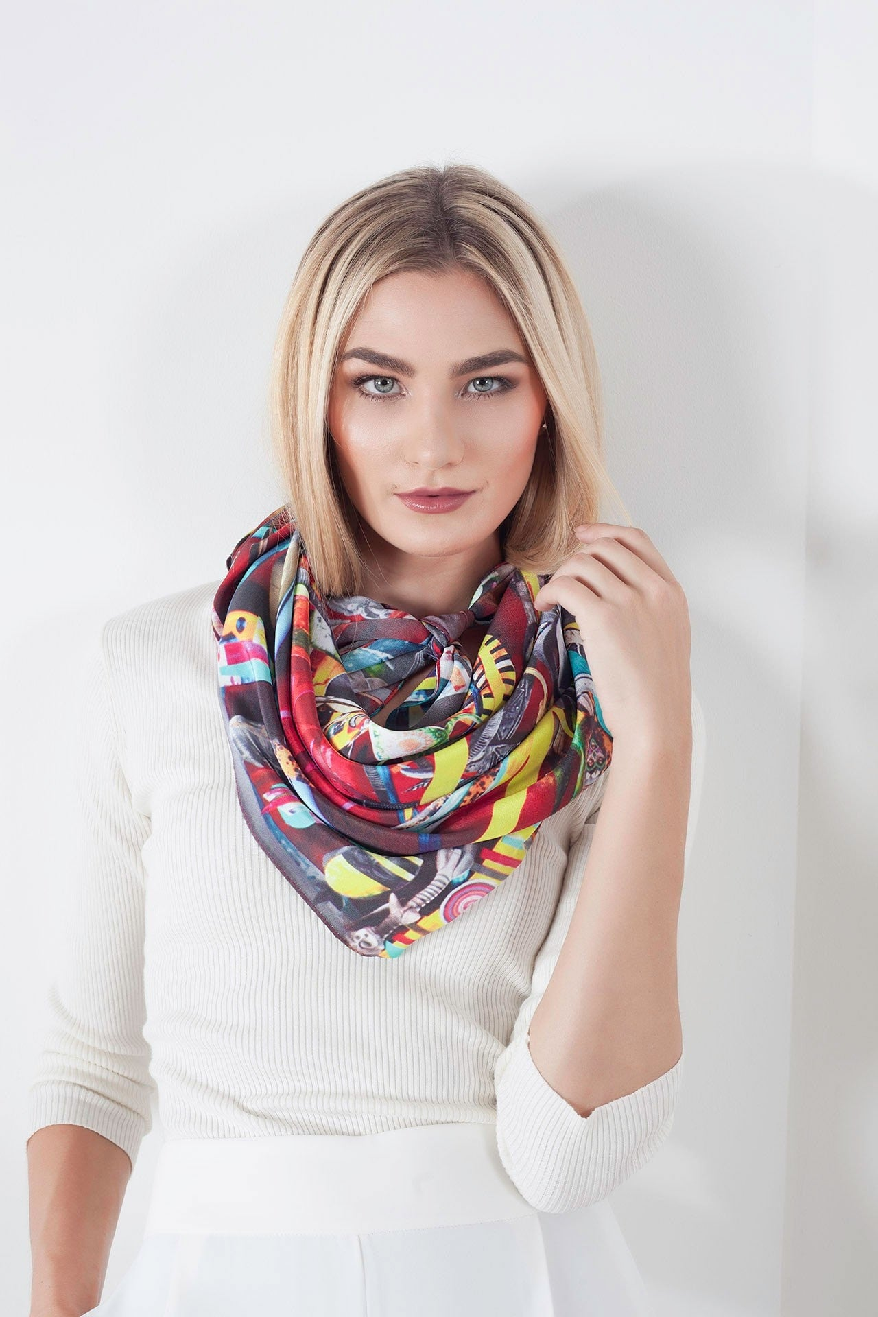 Model wearing a magnificent 100% silk uniquely designed scarf. This wearable art piece was designed in collaboration with Pepe Mar.