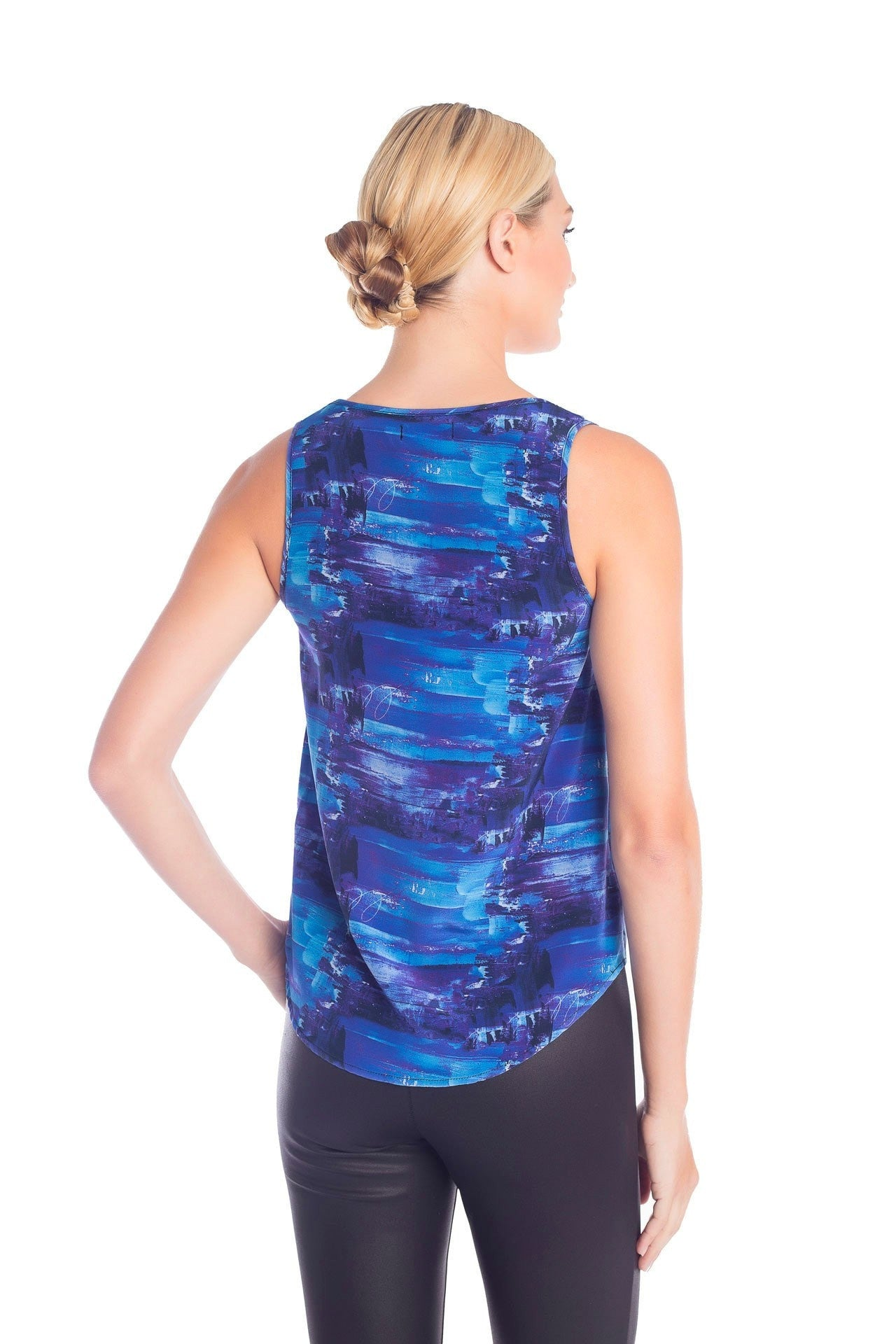 Back view of formal sleeveless top with blue print designed by artist Damian Stamer
