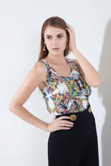 Styled view of fashionable tops for women with multi-color print designed by artist Pepe Mar
