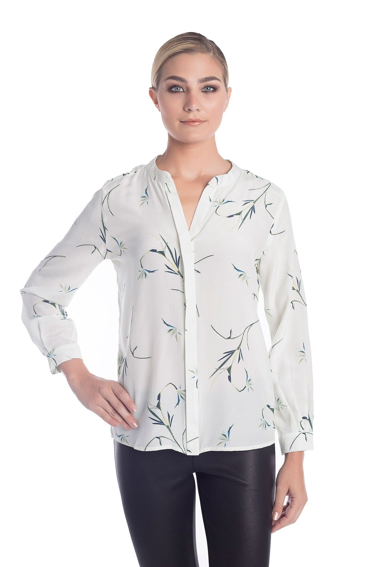 Front view of our dainty and feminine classy women's clothing line. The main visible blouse is white silk with a repeated pattern.