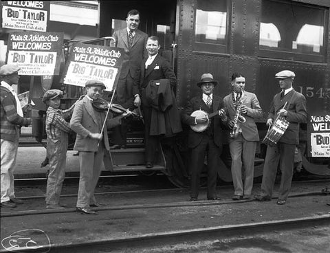 "Figure 7: The Main Street Gym band and newsie supporters welcoming boxer ""Bud"" Taylor at the train station. Los Angeles Public Library"