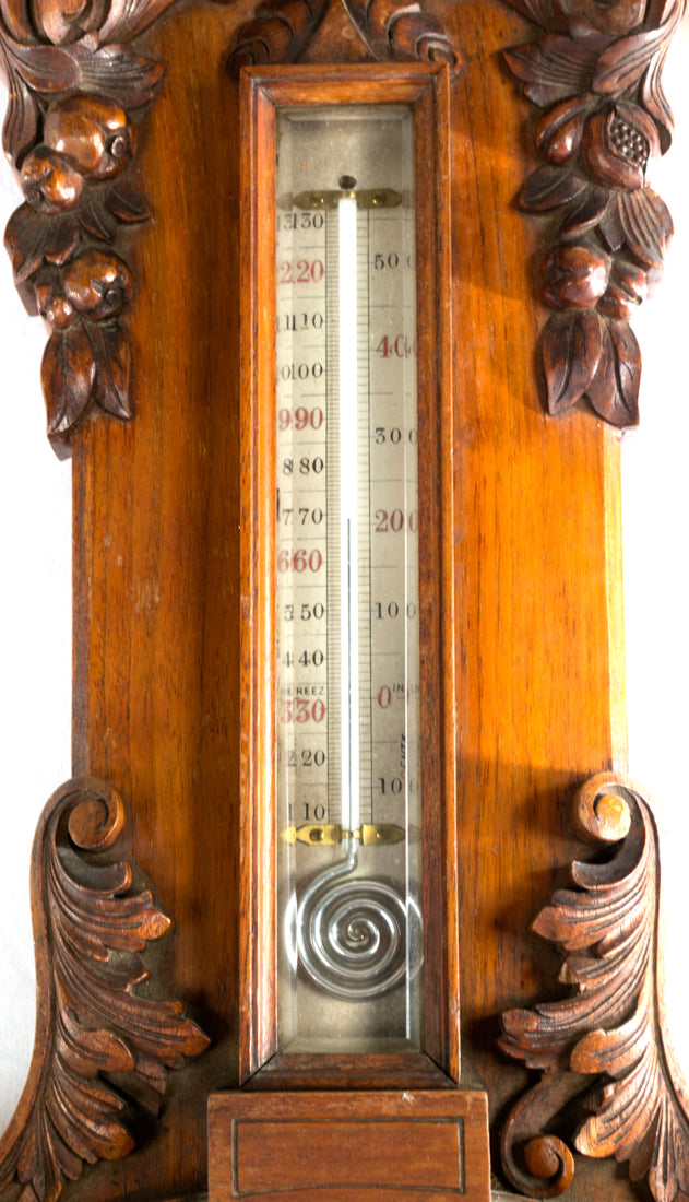 An English Carved Walnut Barometer and Thermometer