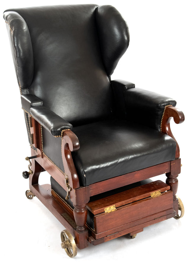 An Adjustable Mahogany, Brass, and Leather Bergere Invalid's Wheel Chair (1880)
