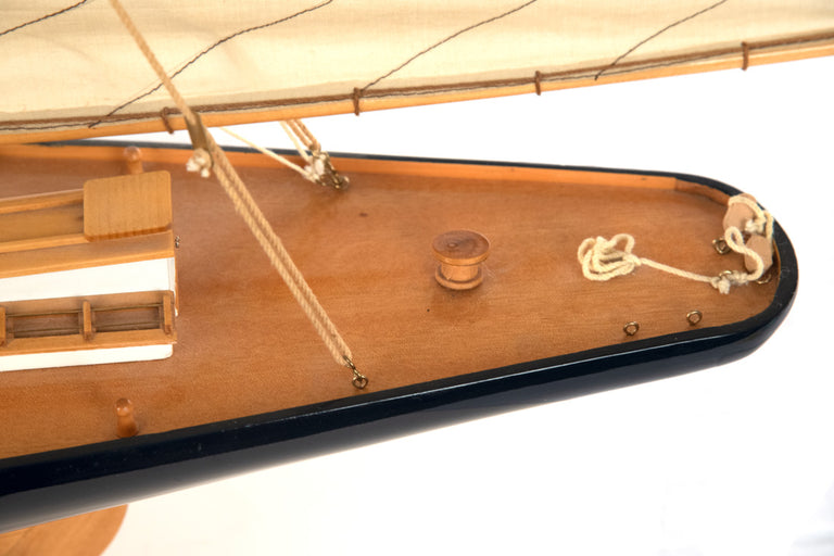 A Carved Wood Sailboat Scale Ship Model on Stand
