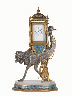 A Gilt and Silvered Bronze and Cloisonné Figural Clock