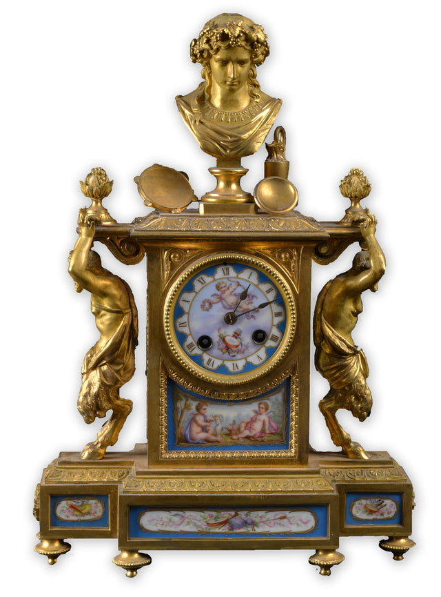 Empire Clock with Sevres Plaques and Gilt Sculptures of Bacchus and Satyrs
