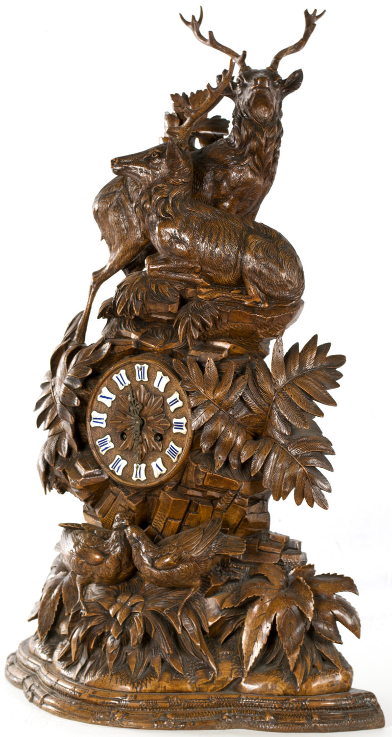 A Large Black Forest Mantel Clock with Red Stags and Game Birds
