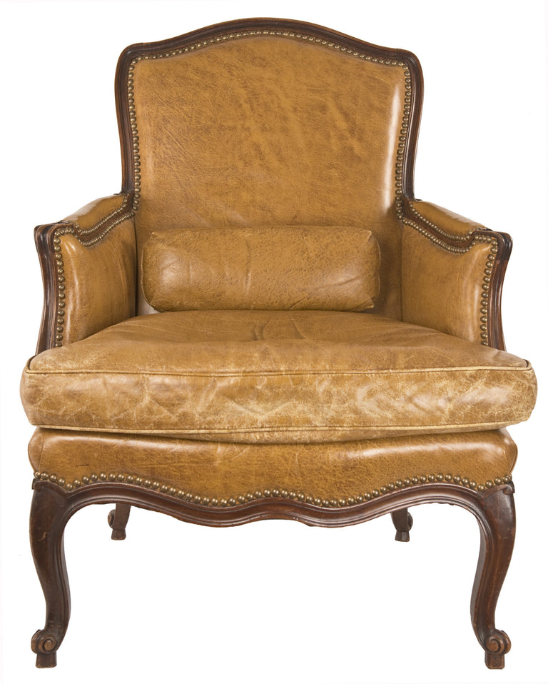 A Louis XV Style Walnut Bergere and Tabouret